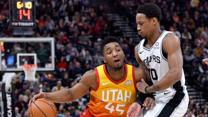 SALT LAKE CITY, UT – FEBRUARY 09: DeMar DeRozan #10 of the San Antonio Spurs defends against Donovan Mitchell #45 of the Utah Jazz in the first half of an NBA game (Photo by Gene Sweeney Jr./Getty Images)