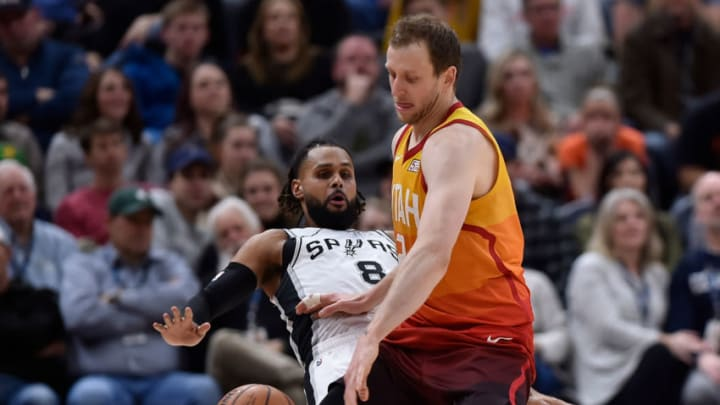 SALT LAKE CITY, UT - FEBRUARY 09: Joe Ingles #2 of the Utah Jazz pushes away defender Patty Mills #8 of the San Antonio Spurs in the second half of a NBA game at Vivint Smart Home Arena on February 09, 2019 in Salt Lake City, Utah. NOTE TO USER: User expressly acknowledges and agrees that, by downloading and or using this photograph, User is consenting to the terms and conditions of the Getty Images License Agreement. (Photo by Gene Sweeney Jr./Getty Images)