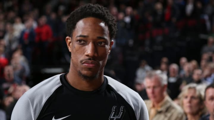 PORTLAND, OR - FEBRUARY 7: DeMar DeRozan #10 of the San Antonio Spurs stands for the National Anthem before the game against the Portland Trail Blazers on February 7, 2019 at the Moda Center Arena in Portland, Oregon. NOTE TO USER: User expressly acknowledges and agrees that, by downloading and or using this photograph, user is consenting to the terms and conditions of the Getty Images License Agreement. Mandatory Copyright Notice: Copyright 2019 NBAE (Photo by Sam Forencich/NBAE via Getty Images)