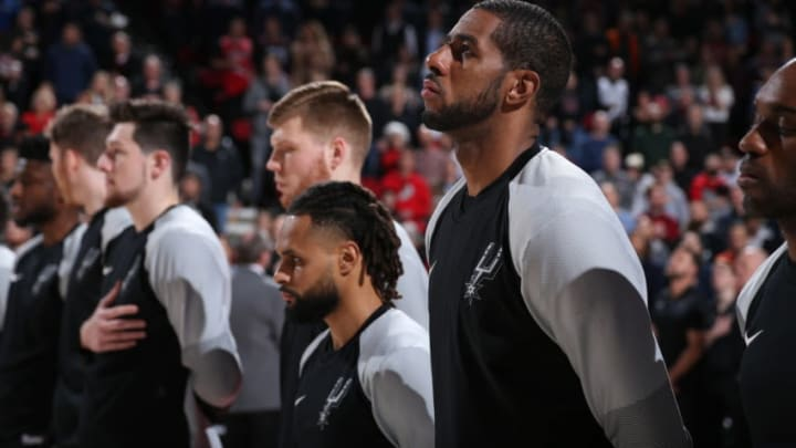 PORTLAND, OR - FEBRUARY 7: LaMarcus Aldridge #12 of the San Antonio Spurs stands for the National Anthem before the game against the Portland Trail Blazers on February 7, 2019 at the Moda Center Arena in Portland, Oregon. NOTE TO USER: User expressly acknowledges and agrees that, by downloading and or using this photograph, user is consenting to the terms and conditions of the Getty Images License Agreement. Mandatory Copyright Notice: Copyright 2019 NBAE (Photo by Sam Forencich/NBAE via Getty Images)