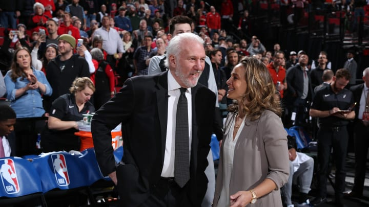 PORTLAND, OR – FEBRUARY 7: Head Coach Gregg Popovich, and Assistant Coach Becky Hammon of the San Antonio Spurs are seen talking together before the game against the Portland Trail Blazers on February 7, 2019 at the Moda Center Arena in Portland, Oregon. (Photo by Sam Forencich/NBAE via Getty Images)