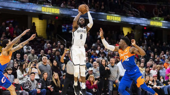 CLEVELAND, OH – FEBRUARY 13: The Cleveland Cavaliers try to block DeMarre Carroll #9 of the Brooklyn Nets as he hits a buzzer beater to send the game into it's third overtime (Photo by Jason Miller/Getty Images)
