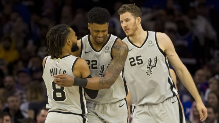 PHILADELPHIA, PA – JANUARY 23: Patty Mills #8, Rudy Gay #22, and Jakob Poeltl #25 of the San Antonio Spurs react against the Philadelphia 76ers (Photo by Mitchell Leff/Getty Images)