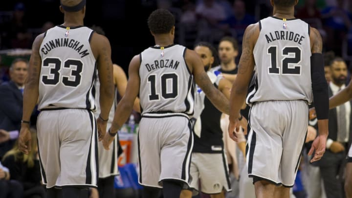 PHILADELPHIA, PA – JANUARY 23: Dante Cunningham #33, DeMar DeRozan #10, and LaMarcus Aldridge #12 of the San Antonio Spurs walk to the bench against the Philadelphia 76ers at the Wells Fargo Center on January 23, 2019 in Philadelphia, Pennsylvania. The 76ers defeated the Spurs 122-120. (Photo by Mitchell Leff/Getty Images)