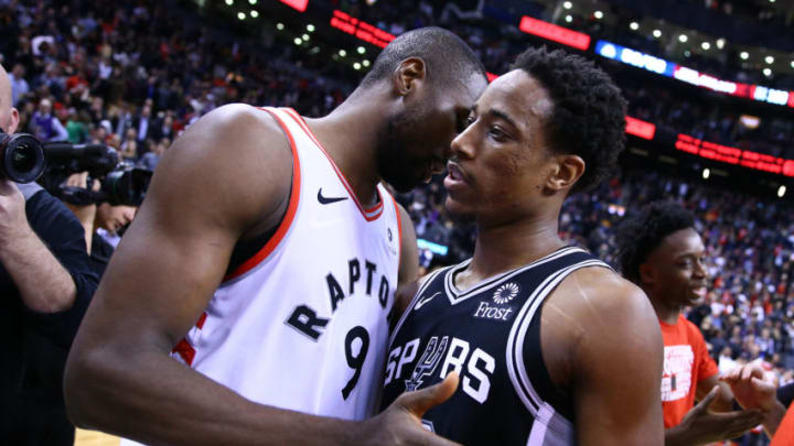 TORONTO, ON - FEBRUARY 22: DeMar DeRozan #10 of the San Antonio Spurs hugs Serge Ibaka #9 of the Toronto Raptors following an NBA game at Scotiabank Arena. (Photo by Vaughn Ridley/Getty Images)