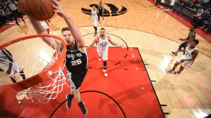 TORONTO, CANADA - FEBRUARY 22: Jakob Poeltl #25 of the San Antonio Spurs dunks the ball against the Toronto Raptors on February 22, 2019 (Photo by Ron Turenne/NBAE via Getty Images)