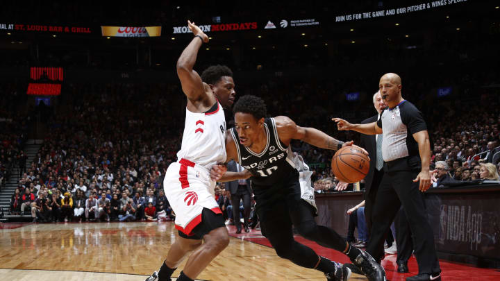 TORONTO, CANADA – FEBRUARY 22: DeMar DeRozan #10 of the San Antonio Spurs handles the ball against Kyle Lowry #7 of the Toronto Raptors (Photo by Mark Blinch/NBAE via Getty Images)