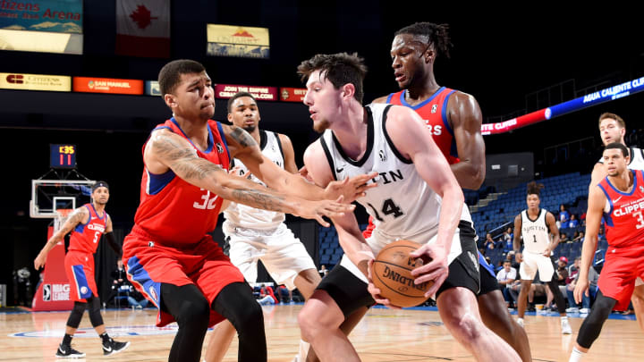 ONTARIO, CA – FEBRUARY 26: Drew Eubanks #14 of the San Antonio Spurs handles the ball against Marc Loving #32 of the Agua Caliente Clippers of Ontario on February 26, 2019 at Citizens Business Bank Arena in Ontario, California. (Photo by Juan Ocampo/NBAE via Getty Images)
