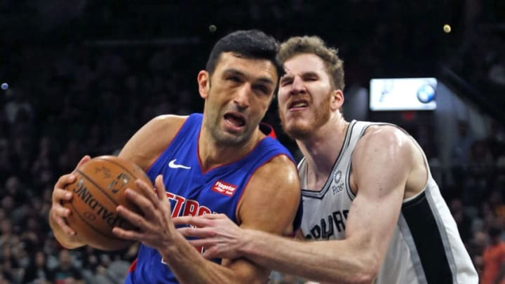 SAN ANTONIO, TX - FEBRUARY 27: Zaza Pachouli #27 of the Detroit Pistons drives on Jakob Poeltl #25 of the San Antonio Spurs at AT&T Center on February 27, 2019 in San Antonio, Texas. NOTE TO USER: User expressly acknowledges and agrees that , by downloading and or using this photograph, User is consenting to the terms and conditions of the Getty Images License Agreement. (Photo by Ronald Cortes/Getty Images)