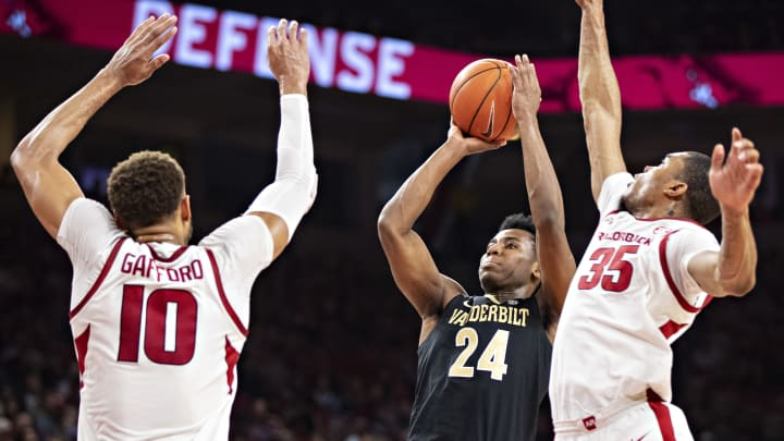 FAYETTEVILLE, AR – FEBRUARY 5: Aaron Nesmith #24 of the Vanderbilt Commodores goes up for shot against Daniel Gafford #10 and Reggie Chaney #35 of the Arkansas Razorbacks at Bud Walton Arena on February 5, 2019 in Fayetteville, Arkansas. The Razorbacks defeated the Commodores 69-66. (Photo by Wesley Hitt/Getty Images)