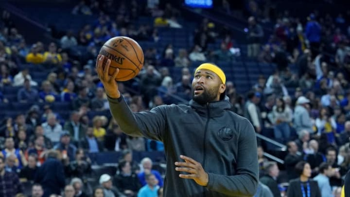 OAKLAND, CA - FEBRUARY 06: DeMarcus Cousins #0 of the Golden State Warriors warms up prior to the start of an NBA basketball game against the San Antonio Spurs at ORACLE Arena on February 6, 2019 in Oakland, California. NOTE TO USER: User expressly acknowledges and agrees that, by downloading and or using this photograph, User is consenting to the terms and conditions of the Getty Images License Agreement. (Photo by Thearon W. Henderson/Getty Images)