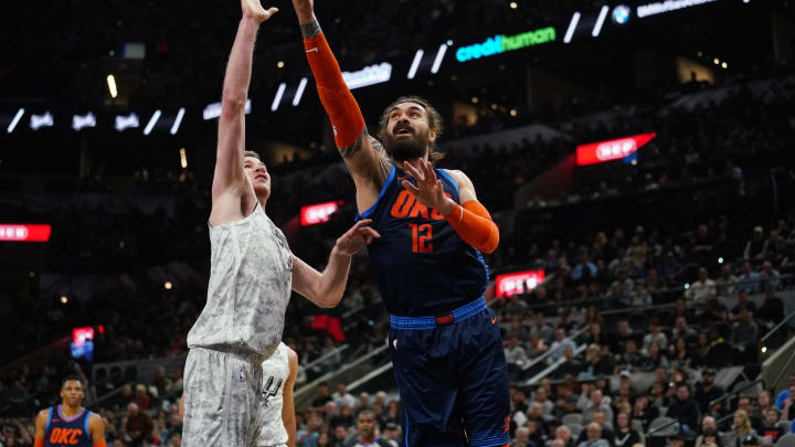 SAN ANTONIO, TX – MARCH 2: Steven Adams #12 of the Oklahoma City Thunder drives to the basket during the game against Jakob Poeltl #25 of the San Antonio Spurs (Photos by Darren Carroll/NBAE via Getty Images)
