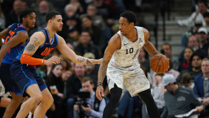 SAN ANTONIO, TX - MARCH 2: DeMar DeRozan #10 of the San Antonio Spurs jocks for a position during the game against Abdel Nader #11 of the Oklahoma City Thunder on March 2, 2019 at the AT&T Center in San Antonio, Texas. NOTE TO USER: User expressly acknowledges and agrees that, by downloading and or using this photograph, user is consenting to the terms and conditions of the Getty Images License Agreement. Mandatory Copyright Notice: Copyright 2019 NBAE (Photos by Darren Carroll/NBAE via Getty Images)