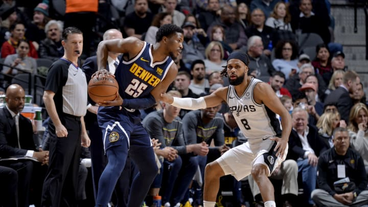 SAN ANTONIO, TX – MARCH 4: Malik Beasley #25 of the Denver Nuggets handles the ball while Patty Mills #8 of the San Antonio Spurs plays defense during the game on March 4, 2019 at the AT&T Center in San Antonio, Texas. (Photos by Mark Sobhani/NBAE via Getty Images)