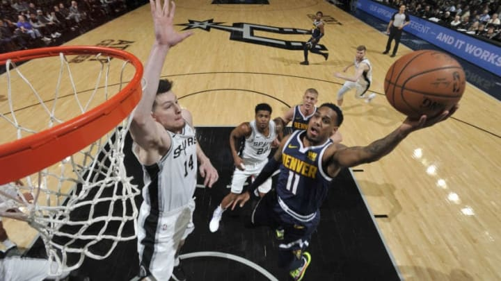 SAN ANTONIO, TX - MARCH 4: Drew Eubanks #14 of the San Antonio Spurs blocks the shot by Monte Morris #11 of the Denver Nuggets on March 4, 2019 at the AT&T Center in San Antonio, Texas. NOTE TO USER: User expressly acknowledges and agrees that, by downloading and or using this photograph, user is consenting to the terms and conditions of the Getty Images License Agreement. Mandatory Copyright Notice: Copyright 2019 NBAE (Photos by Mark Sobhani/NBAE via Getty Images)