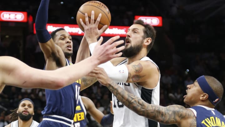SAN ANTONIO, TX – MARCH 4: Marco Belinelli #18 of the San Antonio Spurs shoots past Monte Morris #11 of the Denver Nuggets and Isaiah Thomas #0 at AT&T Center on March 4, 2019 in San Antonio, Texas. (Photo by Ronald Cortes/Getty Images)