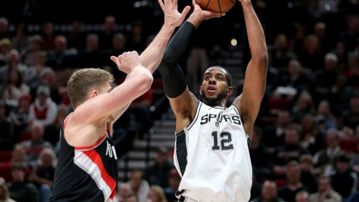 PORTLAND, OR – FEBRUARY 07: LaMarcus Aldridge #12 of the San Antonio Spurs takes a shot against Meyers Leonard #11 of the Portland Trail Blazers in the first quarter during their game at Moda Center on February 7, 2019 in Portland, Oregon. (Photo by Abbie Parr/Getty Images)
