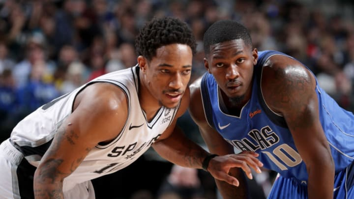 DALLAS, TX - MARCH 12: DeMar DeRozan #10 of the San Antonio Spurs and Dorian Finney-Smith #10 of the Dallas Mavericks look on during the game on March 12, 2019 at the American Airlines Center in Dallas, Texas. NOTE TO USER: User expressly acknowledges and agrees that, by downloading and/or using this photograph, user is consenting to the terms and conditions of the Getty Images License Agreement. Mandatory Copyright Notice: Copyright 2019 NBAE (Photo by Glenn James/NBAE via Getty Images)
