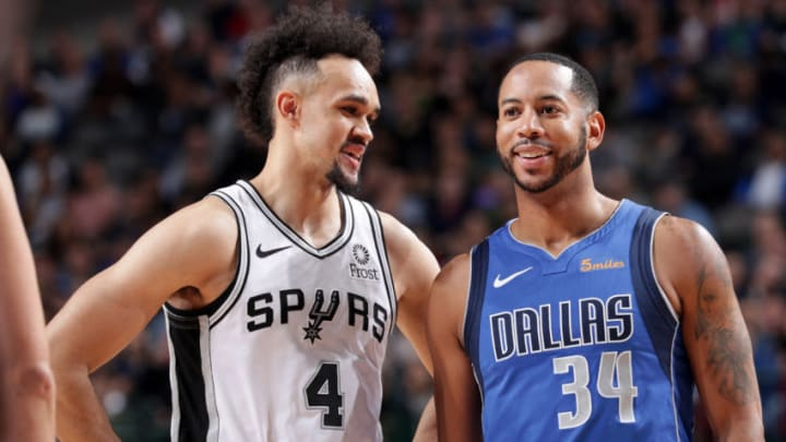 DALLAS, TX - MARCH 12: Derrick White #4 of the San Antonio Spurs and Devin Harris #34 of the Dallas Mavericks talk during the game on March 12, 2019 at the American Airlines Center in Dallas, Texas. NOTE TO USER: User expressly acknowledges and agrees that, by downloading and/or using this photograph, user is consenting to the terms and conditions of the Getty Images License Agreement. Mandatory Copyright Notice: Copyright 2019 NBAE (Photo by Glenn James/NBAE via Getty Images)