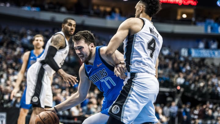 DALLAS, TX – MARCH 12: (EDITORS NOTE: Image has been digitally enhanced.) Luka Doncic #77 of the Dallas Mavericks drives to the basket against the San Antonio Spurs (Photo by Sean Berry/NBAE via Getty Images)