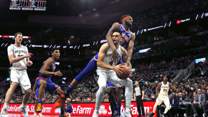 SAN ANTONIO, TX - MARCH 15: Derrick White #4 of the San Antonio Spurs is fouled by Mitchell Robinson #26 of the New York Knicks at AT&T Center on March 15, 2019 in San Antonio, Texas. NOTE TO USER: User expressly acknowledges and agrees that , by downloading and or using this photograph, User is consenting to the terms and conditions of the Getty Images License Agreement. (Photo by Ronald Cortes/Getty Images)
