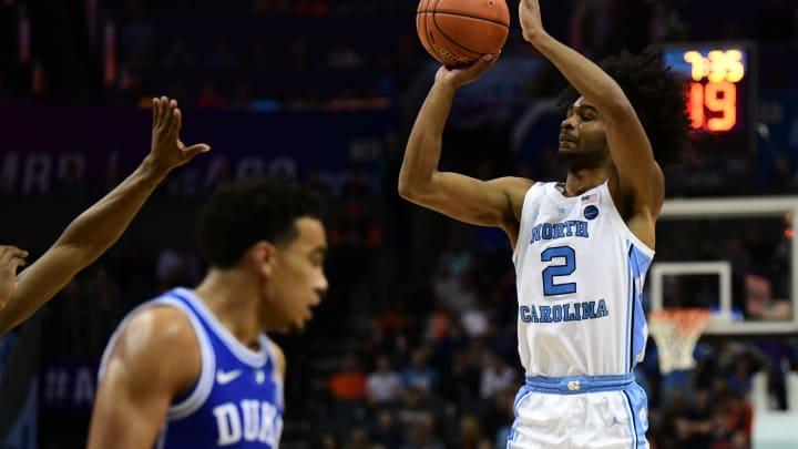 CHARLOTTE, NC – MARCH 15: NBA Draft prospect Coby White (2) shoots an open three point shot during the ACC basketball tournament between the Duke Blue Devils and the North Carolina Tar Heels on March 15, 2019, at the Spectrum Center in Charlotte, NC. (Photo by William Howard/Icon Sportswire via Getty Images)