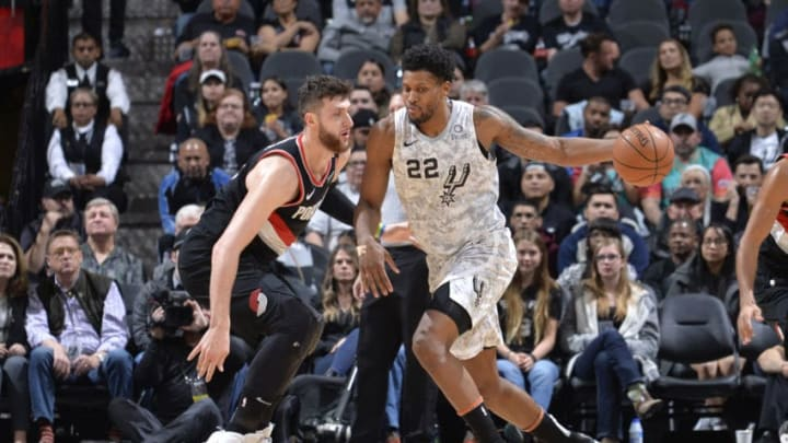 SAN ANTONIO, TX - MARCH 16: Rudy Gay #22 of the San Antonio Spurs posts up on Jusuf Nurkic #27 of the Portland Trail Blazers on March 16, 2019 at the AT&T Center in San Antonio, Texas. NOTE TO USER: User expressly acknowledges and agrees that, by downloading and or using this photograph, user is consenting to the terms and conditions of the Getty Images License Agreement. Mandatory Copyright Notice: Copyright 2019 NBAE (Photos by Mark Sobhani/NBAE via Getty Images)
