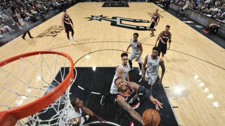 Damian Lillard of the Portland Trail Blazers drives to the basket for layup against the San Antonio Spurs. (Photos by Mark Sobhani/NBAE via Getty Images)