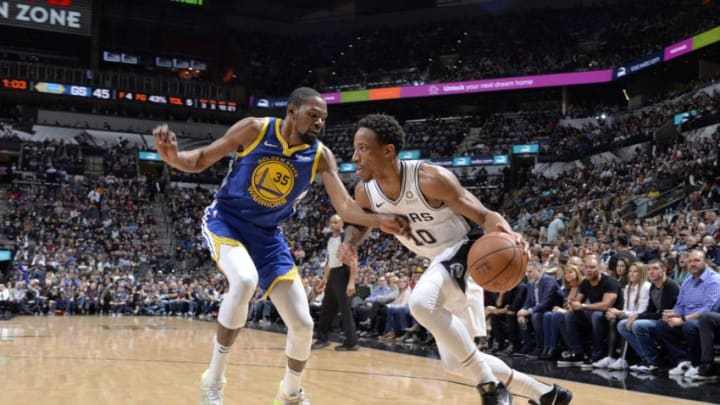 SAN ANTONIO, TX - MARCH 18: DeMar DeRozan #10 of the San Antonio Spurs drives to the basket during the game against the Golden State Warriors on March 18, 2019 at the AT&T Center in San Antonio, Texas. NOTE TO USER: User expressly acknowledges and agrees that, by downloading and or using this photograph, user is consenting to the terms and conditions of the Getty Images License Agreement. Mandatory Copyright Notice: Copyright 2019 NBAE (Photos by Mark Sobhani/NBAE via Getty Images)