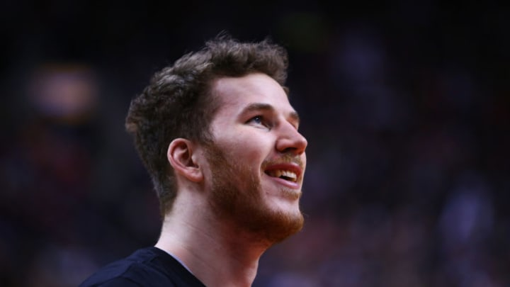 TORONTO, ON - FEBRUARY 22: Jakob Poeltl #25 of the San Antonio Spurs looks on during warm up prior to an NBA game against the Toronto Raptors at Scotiabank Arena (Photo by Vaughn Ridley/Getty Images)