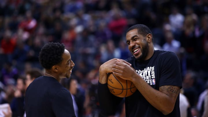 TORONTO, ON – FEBRUARY 22: DeMar DeRozan #10 of the San Antonio Spurs jokes with LaMarcus Aldridge #12 during warm up prior to an NBA game against the Toronto Raptors (Photo by Vaughn Ridley/Getty Images)