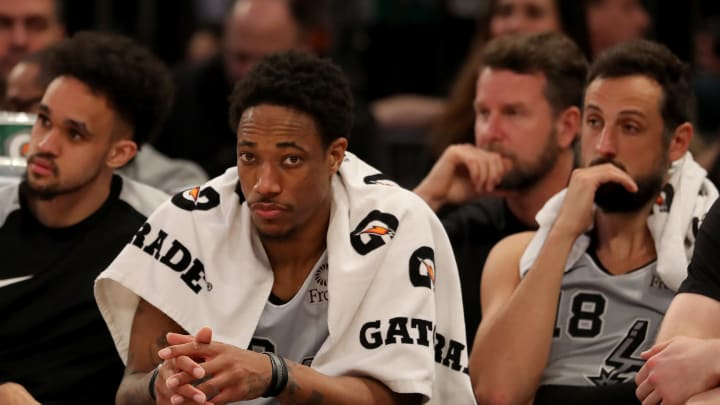 NEW YORK, NEW YORK – FEBRUARY 24: DeMar DeRozan #10 and Marco Belinelli #18 of the San Antonio Spurs react on the bench as the New York Knicks win the game at Madison Square Garden (Photo by Elsa/Getty Images)