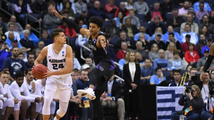 COLUMBUS, OH - MARCH 22: Diogo Brito #24 of the Utah State Aggies looks for an open pass as Matisse Thybulle #4 of the Washington Huskies defends in the first round of the 2019 NCAA Men's Basketball Tournament held at Nationwide Arena on March 22, 2019 in Columbus, Ohio. (Photo by Jamie Schwaberow/NCAA Photos via Getty Images)