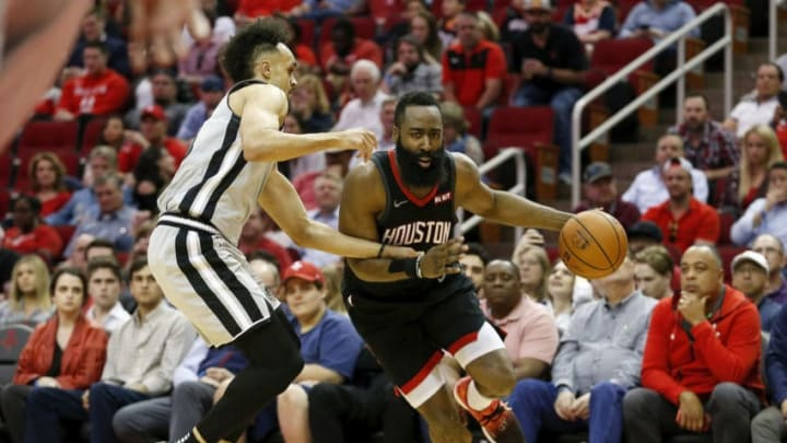 HOUSTON, TX - MARCH 22: James Harden #13 of the Houston Rockets drives to the basket defended by Derrick White #4 of the San Antonio Spurs in the first half at Toyota Center on March 22, 2019 in Houston, Texas. NOTE TO USER: User expressly acknowledges and agrees that, by downloading and or using this photograph, User is consenting to the terms and conditions of the Getty Images License Agreement. (Photo by Tim Warner/Getty Images)