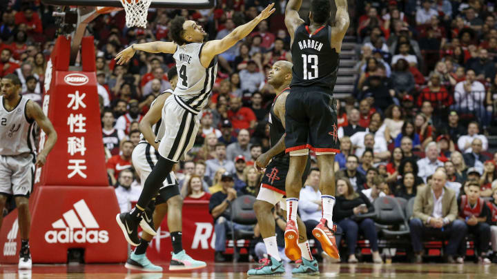 HOUSTON, TX – MARCH 22: James Harden #13 of the Houston Rockets takes a three point shot defended by Derrick White #4 of the San Antonio Spurs (Photo by Tim Warner/Getty Images)