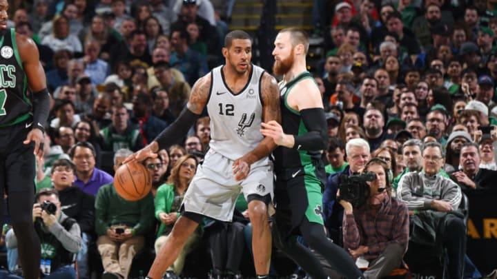 LaMarcus Aldridge of the San Antonio Spurs handles the ball against the Boston Celtics. (Photo by Brian Babineau/NBAE via Getty Images)