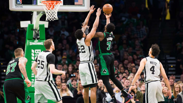 BOSTON, MA – MARCH 24: Jaylen Brown #7 of the Boston Celtics drives against Rudy Gay #22 of the San Antonio Spurs (Photo by Kathryn Riley/Getty Images)