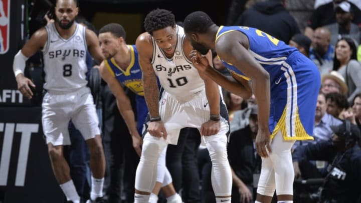 SAN ANTONIO, TX - MARCH 18: DeMar DeRozan #10 of the San Antonio Spurs and Draymond Green #23 of the Golden State Warriors talk during a game on March 18, 2019 at the AT&T Center in San Antonio, Texas. NOTE TO USER: User expressly acknowledges and agrees that, by downloading and or using this photograph, user is consenting to the terms and conditions of the Getty Images License Agreement. Mandatory Copyright Notice: Copyright 2019 NBAE (Photos by Mark Sobhani/NBAE via Getty Images)
