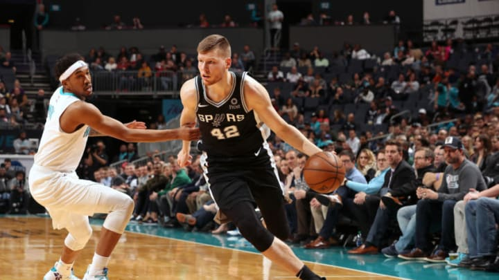 CHARLOTTE, NC - MARCH 26: Davis Bertans #42 of the San Antonio Spurs handles the ball against the Charlotte Hornets on March 26, 2019 at the Spectrum Center in Charlotte, North Carolina. NOTE TO USER: User expressly acknowledges and agrees that, by downloading and/or using this photograph, user is consenting to the terms and conditions of the Getty Images License Agreement. Mandatory Copyright Notice: Copyright 2019 NBAE (Photo by Kent Smith/NBAE via Getty Images)