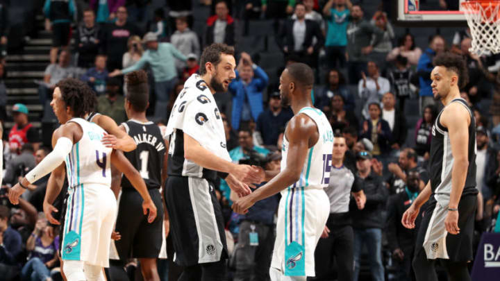 CHARLOTTE, NC - MARCH 26: Marco Belinelli #18 of the San Antonio Spurs and Kemba Walker #15 of the Charlotte Hornets shake hands after the game on March 26, 2019 at the Spectrum Center in Charlotte, North Carolina. NOTE TO USER: User expressly acknowledges and agrees that, by downloading and/or using this photograph, user is consenting to the terms and conditions of the Getty Images License Agreement. Mandatory Copyright Notice: Copyright 2019 NBAE (Photo by Kent Smith/NBAE via Getty Images)