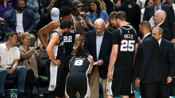 CHARLOTTE, NC - MARCH 26: Head Coach Gregg Popovich of the San Antonio Spurs draws up a play during the game against the Charlotte Hornets on March 26, 2019 at the Spectrum Center in Charlotte, North Carolina. NOTE TO USER: User expressly acknowledges and agrees that, by downloading and/or using this photograph, user is consenting to the terms and conditions of the Getty Images License Agreement. Mandatory Copyright Notice: Copyright 2019 NBAE (Photo by Brock Williams-Smith/NBAE via Getty Images)