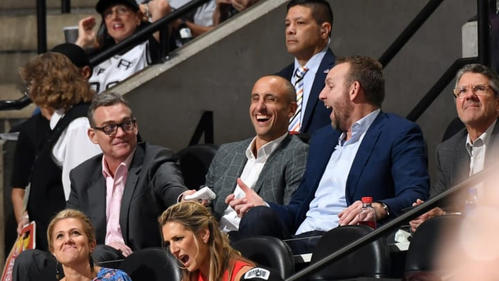SAN ANTONIO, TX – MARCH 28: GM of the San Antonio Spurs, RC Buford, Manu Ginóbili and Sean Marks, attend a game between the Cleveland Cavaliers and the San Antonio Spurs (Photos by Andrew D. Bernstein/NBAE via Getty Images)