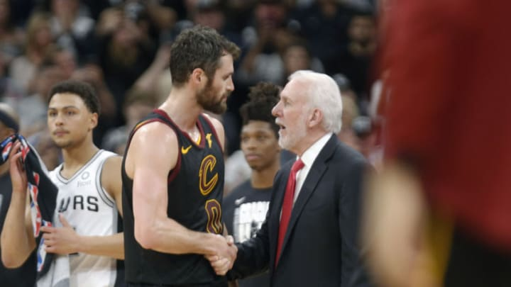 SAN ANTONIO, TX - MARCH 28: Gregg Popovich head coach of the San Antonio Spurs congratulates Kevin Love #0 of the Cleveland Cavaliers at the end of the game at AT&T Center on March 28, 2019 in San Antonio, Texas. (Photo by Ronald Cortes/Getty Images)