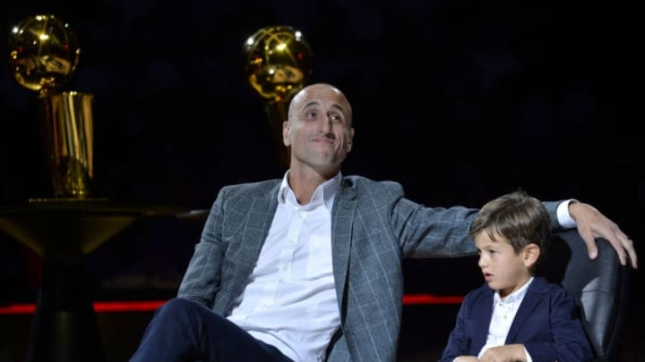 SAN ANTONIO, TX - MARCH 28: Retired San Antonio Spurs Player Manu Ginobili is honored during his Jersey Retirement Ceremony alongside his son after the game between the San Antonio Spurs and Cleveland Cavaliers on March 28, 2018 at the AT&T Center in San Antonio, Texas. NOTE TO USER: User expressly acknowledges and agrees that, by downloading and or using this photograph, user is consenting to the terms and conditions of the Getty Images License Agreement. Mandatory Copyright Notice: Copyright 2018 NBAE (Photos by Mark Sobhani/NBAE via Getty Images)