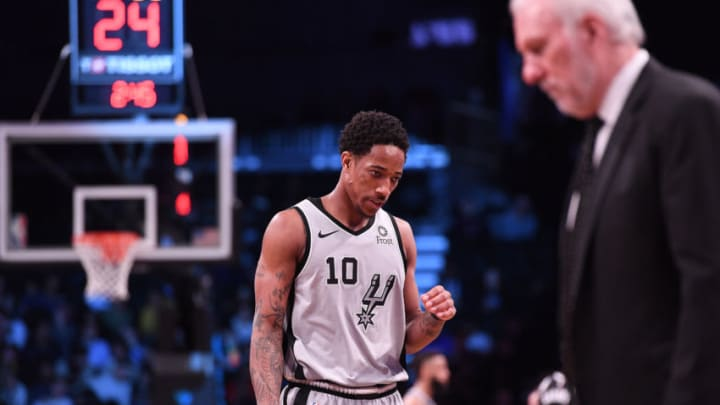 NEW YORK, NY - FEBRUARY 25: DeMar DeRozan #10 and Gregg Popovich of the San Antonio Spurs during the game against the Brooklyn Nets at Barclays Center on February 25, 2019 in the Brooklyn borough of New York City. NOTE TO USER: User expressly acknowledges and agrees that, by downloading and or using this photograph, User is consenting to the terms and conditions of the Getty Images License Agreement. (Photo by Matteo Marchi/Getty Images)