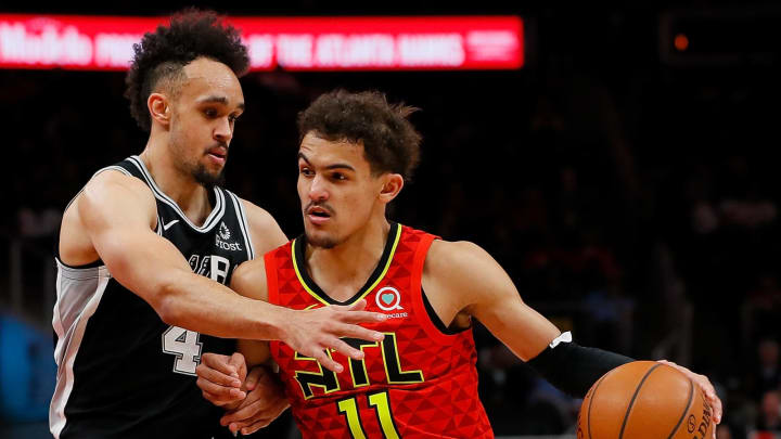 ATLANTA, GEORGIA – MARCH 06: Trae Young #11 of the Atlanta Hawks drives against Derrick White #4 of the San Antonio Spurs at State Farm Arena on March 06, 2019 in Atlanta, Georgia. (Photo by Kevin C. Cox/Getty Images)