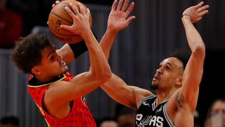 ATLANTA, GEORGIA - MARCH 06: Trae Young #11 of the Atlanta Hawks looks to pass against Derrick White #4 of the San Antonio Spurs (Photo by Kevin C. Cox/Getty Images)