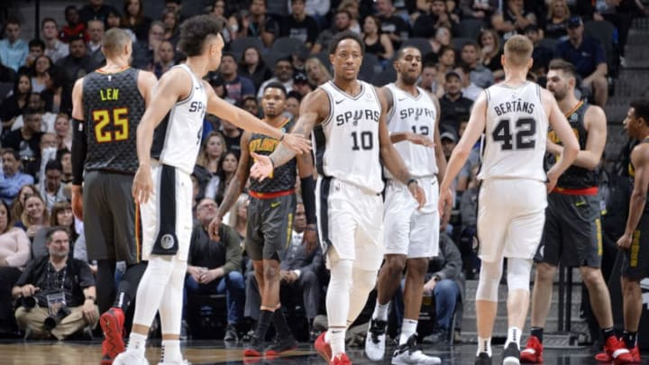 SAN ANTONIO, TX - APRIL 2: DeMar DeRozan #10 of the San Antonio Spurs and Derrick White #4 of the San Antonio Spurs celebrate during the game against the Atlanta Hawks on April 2, 2019 at the AT&T Center in San Antonio, Texas. NOTE TO USER: User expressly acknowledges and agrees that, by downloading and or using this photograph, user is consenting to the terms and conditions of the Getty Images License Agreement. Mandatory Copyright Notice: Copyright 2019 NBAE (Photos by Mark Sobhani/NBAE via Getty Images)