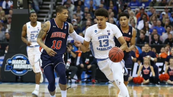 KANSAS CITY, MO – MARCH 29: North Carolina Tar Heels guard Cameron Johnson (13) drives against Auburn Tigers guard Samir Doughty (10) in the second half of an NCAA Midwest Regional Sweet Sixteen game between the Auburn Tigers and North Carolina Tar Heels on March 29, 2019 at Sprint Center in Kansas City, MO. (Photo by Scott Winters/Icon Sportswire via Getty Images)