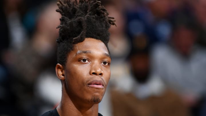 DENVER, CO – APRIL 3: Lonnie Walker IV #1 of the San Antonio Spurs looks on during the game against the Denver Nuggets (Photo by Garrett Ellwood/NBAE via Getty Images)